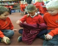 Y1 explore the contents of the mystery bag